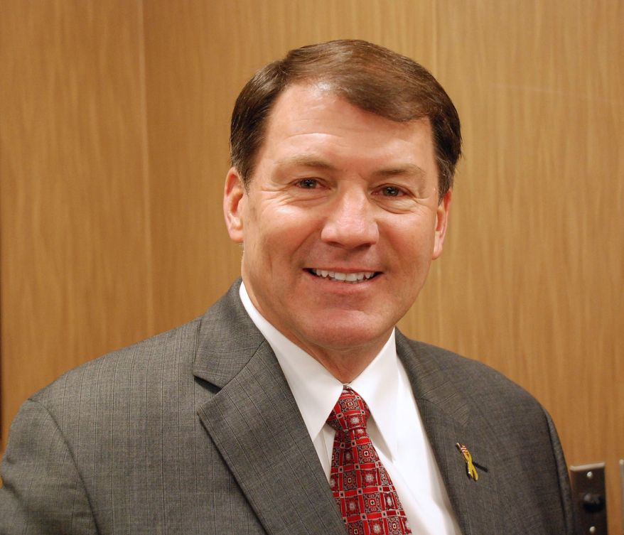 **FILE** Former South Dakota Gov. Mike Rounds smiles Nov. 29, 2012, in Pierre, S.D., at a press conference where he announced he will run for the U.S. Senate in 2012. (Associated Press)