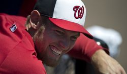 Washington Nationals pitcher Stephen Strasburg jokes around with teammates in the dugout during an exhibition spring training baseball game against the Atlanta Braves on Wednesday, March 27, 2013, in Viera, Fla. (AP Photo/Evan Vucci)
