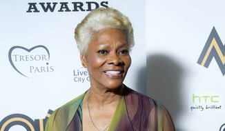 Singer Dionne Warwick is pictured after receiving the Lifetime Achievement Award at the 2012 MOBO Awards in Liverpool, England, on Saturday, Nov. 3, 2012. (Joel Ryan/Invision/AP)