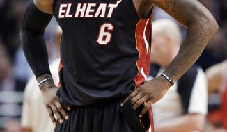 Miami Heat forward LeBron James pauses during the second half of the Heat's 101-97 loss to the Chicago Bulls in an NBA basketball game in Chicago on Wednesday, March 27, 2013. The loss ended the Heat's 27-game winning streak. (AP Photo/Nam Y. Huh)