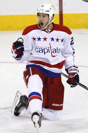 Washington Capitals' Brooks Laich (21) celebrates his goal against the Winnipeg Jets during the first period of an NHL hockey game in Winnipeg, Manitoba, on Friday, March 22, 2013. (AP Photo/The Canadia