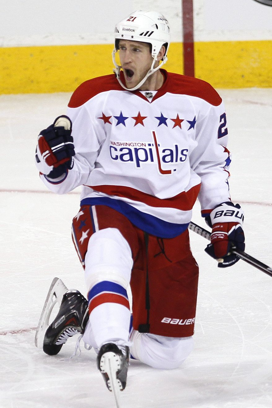 Washington Capitals' Brooks Laich (21) celebrates his goal against the Winnipeg Jets during the first period of an NHL hockey game in Winnipeg, Manitoba, on Friday, March 22, 2013. (AP Photo/The Canadian Press, John Woods)
