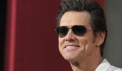 """Actor Jim Carrey arrives at the world premiere of the feature film """"The Incredible Burt Wonderstone"""" at the TCL Chinese Theatre in Los Angeles on March 11, 2013. (Dan Steinberg/Invision/Associated Press) **FILE**"""