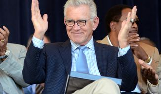 FILE - In this July 21, 2012, file photo, Tim McCarver greets the crowd before accepting the Ford C. Frick Award for excellence in baseball broadcasting as part of the Baseball Hall of Fame Induction ceremonies at Doubleday Field in Cooperstown, N.Y. McCarver says he will step down from his position at Fox after this season. (AP Photo/Heather Ainsworth, File)