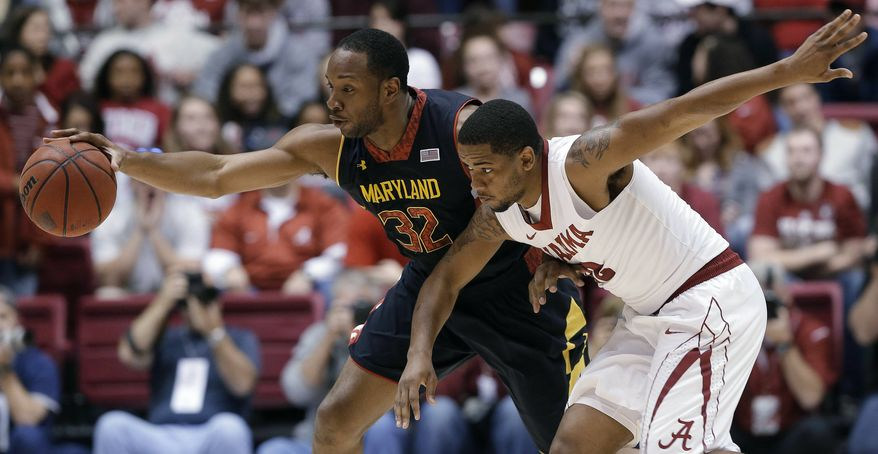 Maryland's Dez Wells (32) keeps the ball from Alabama guard Trevor Releford during the first half of an NIT college basketball game in Tuscaloosa, Ala., Tuesday, March 26, 2013. (AP Photo/Dave Martin)