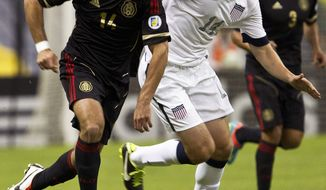 Mexico's Javier Hernandez, left, and United States' Matt Besler vie for the ball during a 2014 World Cup qualifying match at the Aztec stadium in Mexico City, Tuesday, March 26, 2013. (AP Photo/Christian Palma)