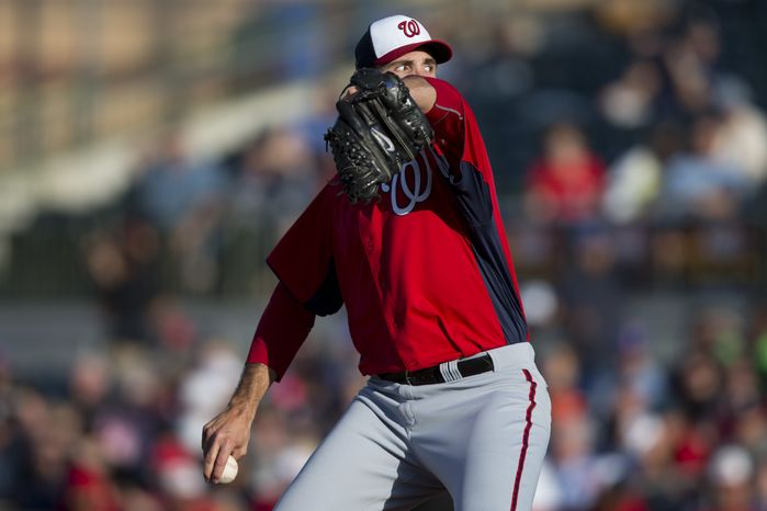 Washington Nationals pitcher Chris Young delivers a pitch during the first inning of a spring training baseball game against the Houston Astros on Monday, March 25, 2013, in Kissimmee, Fla. (AP Photo/Evan Vucci)
