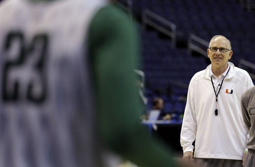 Miami head coach Jim Larranaga keeps an eye on his team during practice for a regional semifinal game in the NCAA college basketball tournament, Wednesday, March 27, 2013, in Washington. Miami will face Marquette on Thursday. (AP Photo/Alex Brandon)