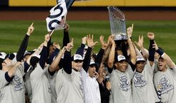 Members of the Yankees gather to celebrate their Word Series victory over Philadelphia in 2009. It was New York's 27th championship. (Associated Press)