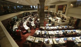 Members of the Alabama House of Representatives debate a bill at the Statehouse in Montgomery, Ala., on Tuesday, March 19, 2013. (AP Photo/Dave Martin)