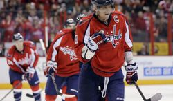 Washington Capitals left wing Alex Ovechkin (8), from Russia, celebrates a goal by center Mike Ribeiro during the second period of an NHL hockey game against the New York Islanders on Tuesday, March 26, 2013, in Washington. (AP Photo/Alex Brandon)