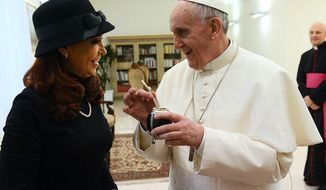 ** FILE ** Argentinian President Cristina Kirchner with Pope Francis in this Twitter photo posted on Kirchner's social media page.