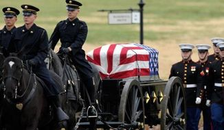 ** FILE ** Marines conduct military funeral services at Arlington cemetery, Dec. 7, 2012. (Associated Press)