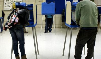 ** FILE ** Voters cast their Election Day ballots on Nov. 6, 2012, in the cafeteria of Handley Elementary School in Saginaw, Mich. (Associated Press/The Saginaw News)