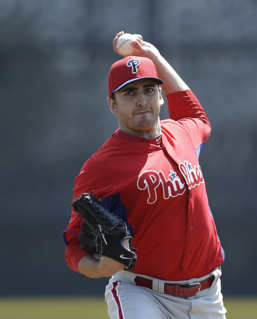 Philadelphia Phillies starting pitcher John Lannan winds up for a warmup pitch in a spring training baseball game in Dunedin, Fla., Monday, March 25, 2013. (AP Photo/Kathy Willens)