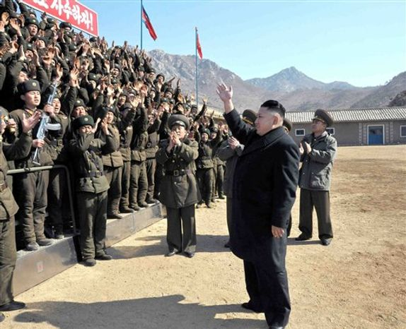 ** FILE ** In this March 11, 2013, photo released by the Korean Central News Agency (KCNA) and distributed March 12, 2013, by the Korea News Service, North Korean leader Kim Jong-un greets military personnel at a long-range artillery sub-unit of KPA Unit 641 during his visit to front-line military units near the western sea boarder in