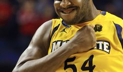 Marquette forward Davante Gardner (54) reaccts after sinking a free throw in the final moments of a third-round NCAA college basketball tournament game against Butler, Saturday, March 23, 2013, in Lexington, Ky. Marquette won 74-72. (AP Photo/James Crisp)