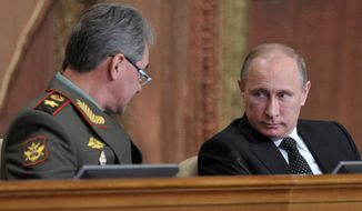 "** FILE ** Russian President Vladimir Putin, right, and Defense Minister Sergei Shoigu attend a meeting with top military officials in Moscow, Wednesday, Feb. 27, 2013. Russian President Vladimir Putin has called on the country's top brass to deliver a drastic upgrade of the armed forces in the next three years to fend off attempts from abroad to ""tip the strategic balance"" in the world. (AP Photo/RIA Novosti, Alexei Nikolsky, Presidential Press Service)"