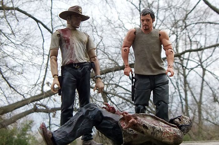 Rick Grimes and Daryl Dixon look over the Autopsy Zombie from McFarlane Toys' The Walking Dead: TV Series 3 colle