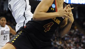 Connecticut's Breanna Stewart, left, fouls Maryland's Malina Howard during the second half of a regional semifinal game in the NCAA college basketball tournament in Bridgeport, Conn., Saturday, March 30, 2013. Connecticut won 76-50. (AP Photo/Jessica Hill)
