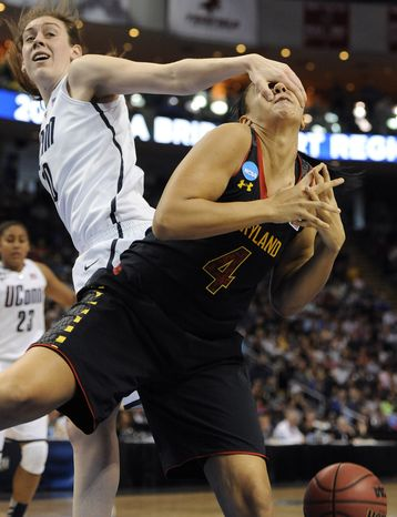 Connecticut's Breanna Stewart, left, fouls Maryland's Malina Howard during the second half of a regional semifinal game in the NCAA college basketball tournam