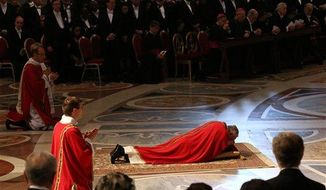 Pope Francis lies down in prayer during the Passion of Christ Mass inside St. Peter's Basilica, at the Vatican, Friday, March 29, 2013. (AP Photo/Gregorio Borgia)