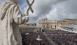 Worshippers crowd St. Peter's Square at the Vatican for Easter Mass on Sunday, March 31, 2013, as Pope Francis marked his first Easter as pontiff. (AP Photo/Alessandra Tarantino)