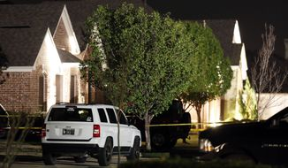 Police caution tape surrounds the home of Kaufman County District Attorney Mike McLelland and his wife, Cynthia McLelland, who were found dead in their home near Forney, Texas, on Saturday, March 30, 2013. (AP Photo/The Dallas Morning News, Ian C. Bates)