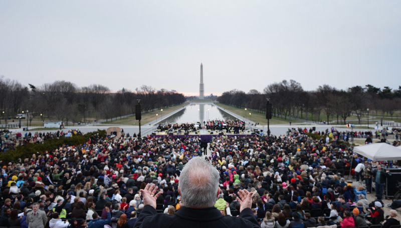 Pastor Amos Dodge (center) of Capital Church leads worshippers in the 35th annual Easter Sunrise Service at the Lincoln Memorial in Washington on Sunday, March 31, 2013. (Andrew Harnik/The Washington Times)