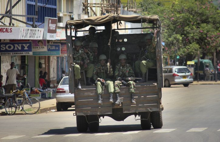 Police from the General Service Unit (GSU) patrol on a street in Kisumu, Kenya, on Sunday, March 31, 2013. Kenyan police deployed forces Sunday in the capital and in the lakeside city of Kisumu, where two people were killed and five seriously injured in riots on Saturday, to contain the continuing threat of violence, officials said, but the country remained mostly peaceful after a high court upheld Uhuru Kenyatta's election as president. (AP Photo)