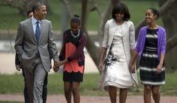 ** FILE ** President Obama and first lady Michelle Obama (second from right) walk from the White House with their daughters, Sasha (second from left) and Malia (right), on their way through Lafayette Park to St. John's Episcopal Church for Easter services on Sunday, March 31, 2013, in Washington. (AP Photo/Carolyn Kaster)