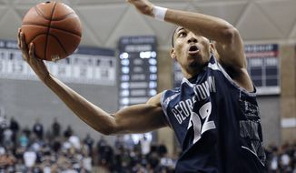 FILE - In this Feb. 27, 2013 file photo, Georgetown's Otto Porter Jr. goes up for the game-winning basket during the second overtime of an NCAA college basketball game against Connecticut in Storrs, Conn. Porter was selected to the AP All-America team Monday, April 1, 2013. (AP Photo/Jessica Hill, File)