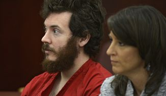 **FILE** Aurora, Colo., theater shooting suspect James Holmes and defense attorney Tamara Brady sit in the courtroom during his arraignment in Centennial, Colo., on Tuesday, March 12, 2013. (Associated Press/Denver Post)