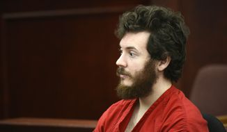 ** FILE ** Aurora, Colo., theater shooting suspect James Holmes sits in the courtroom during his arraignment in Centennial, Colo., on Tuesday, March 12, 2013. (Associated Press/Denver Post)