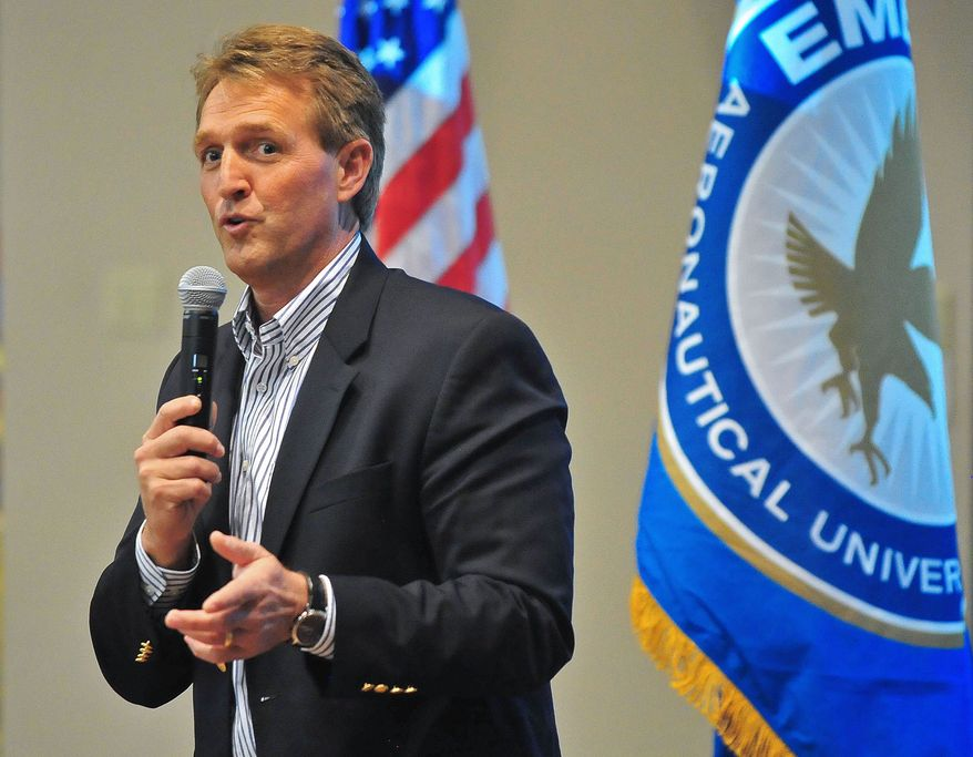 Sen. Jeff Flake, Arizona Republican, answers questions from the crowd about immigration reform, gay marriage and other topics on March 28, 2013, during a town-hall-style meeting at Embry-Riddle Aeronautical University in Prescott, Ariz. (Associated Press/The Daily Courier) ** FILE **