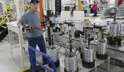 Dietz Werland works on the assembly line at the Chrysler transmission plant in Kokomo, Ind., on Thursday, Feb. 28, 2013. (AP Photo/A.J. Mast)
