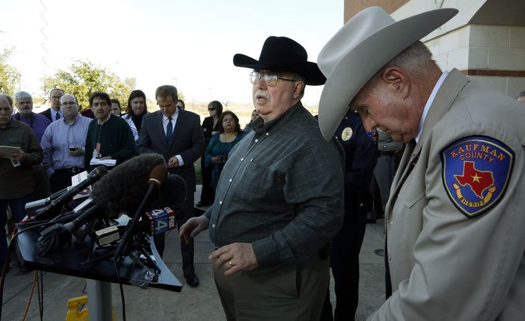**FILE** David Byrnes (right), Sheriff of Kaufman County, bows his head as Mike McLelland, District Attorney of Kaufman County answers questions at a Jan. 31, 2013, news conference at the Kaufman Law Enforcement Center in Kaufman, Texas. (Associated Press/The Dallas Morning News)