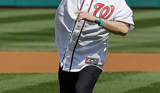 Medal of Honor recipient Army Staff Sgt. Clint Romesha throws out the ceremonial first pitch before the opening day baseball game between the Washington Nationals and the Miami Marlins in Washington, on Monday, April 1, 2013.  (AP Photo/Alex Brandon)