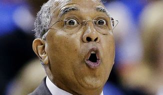FILE - In this March 24, 2013 file photo, Minnesota head coach Tubby Smith yells to his players during the first half of a third-round game of the NCAA college basketball tournament against Florida, in Austin, Texas. Minnesota has fired Smith one day after the Golden Gophers lost to Florida in the NCAA tournament. A person with knowledge of the decision told The Associated Press that Smith was fired on Monday, March 25, 2013. (AP Photo/Eric Gay, File)