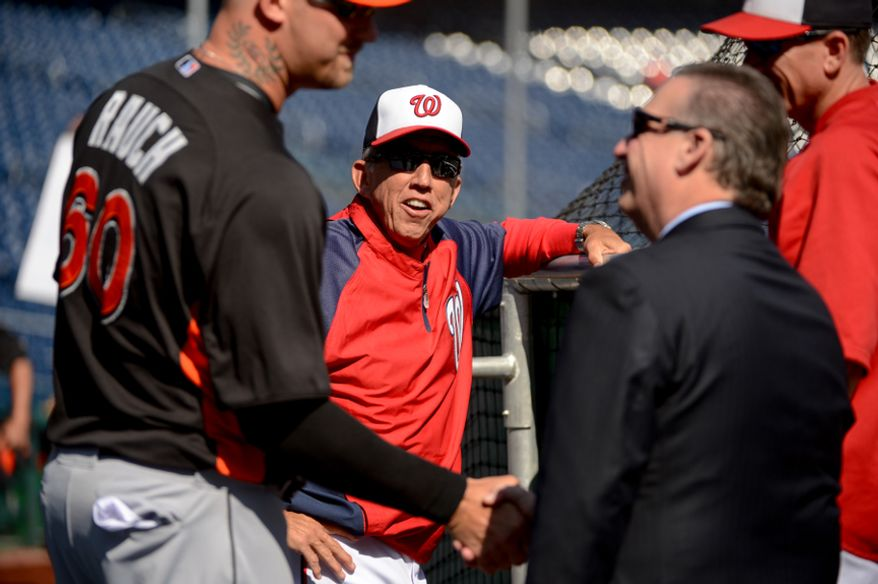 Washington Nationals manager Davey Johnson (5), center, watches warm ups before the Washington Nationals play the Miami Marlins on opening day at Nationals Park, Washington, D.C., Monday, April 1, 2013. (Andrew Harnik/The Washington Times)