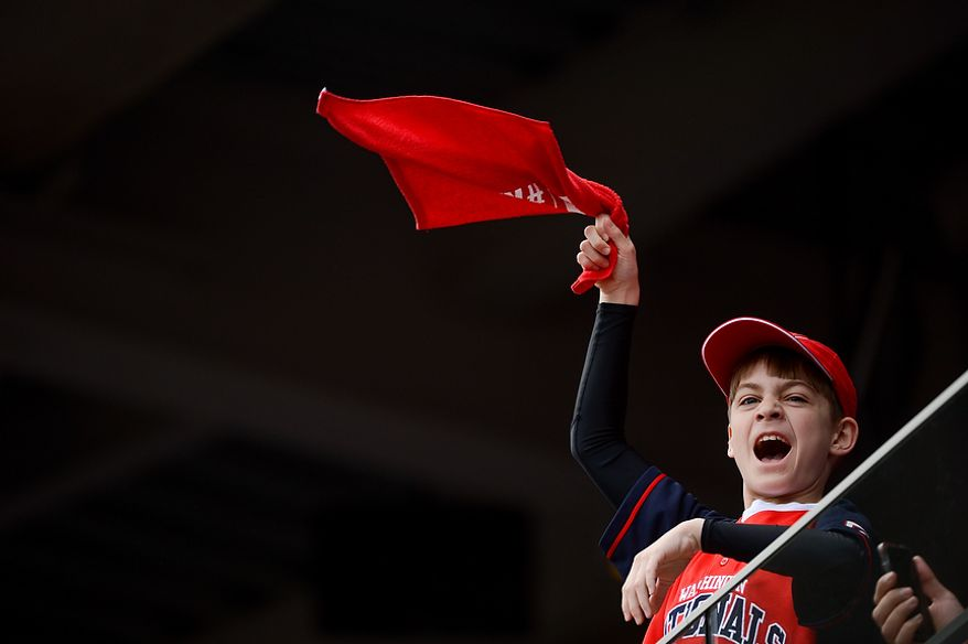 A young fan cheers on the Washington Nationals as they are introduced before they play the Miami Marlins on opening day at Nationals Park, Washington, D.C., Monday, April 1, 2013. (Andrew Harnik/The Washington Times)