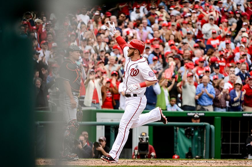 Washington Nationals left fielder Bryce Harper (34) hits his second home run of the game in the bottom of the 4th inning as the Washington Nationals play the Miami Marlins on opening day at Nationals Park, Washington, D.C., Monday, April 1, 2013. (Andrew Harnik/The Washington Times)