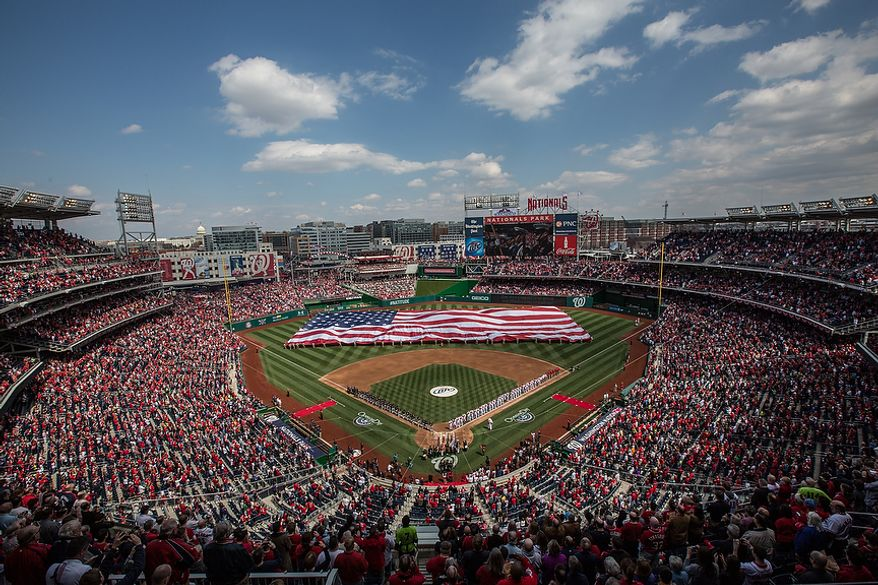 Members of the military unfold a giant flag in the middle of the field during a pre-game ceremony, as the Washington Nationals play the the Miami Marlins on opening day, at Nationals Park, in Washington, DC., Monday, April 1, 2013. (Andrew S Geraci/The Washington Times)
