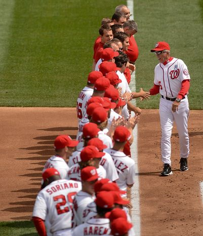 Washington Nationals manager Davey Johnson (5) shakes hands with his team during introductions as the Washington Nationals play the Miami Marlins on opening day at Nationals Park, Washington, D.C., Monday, April 1, 2013. (Andrew Harnik/The Washington Times)