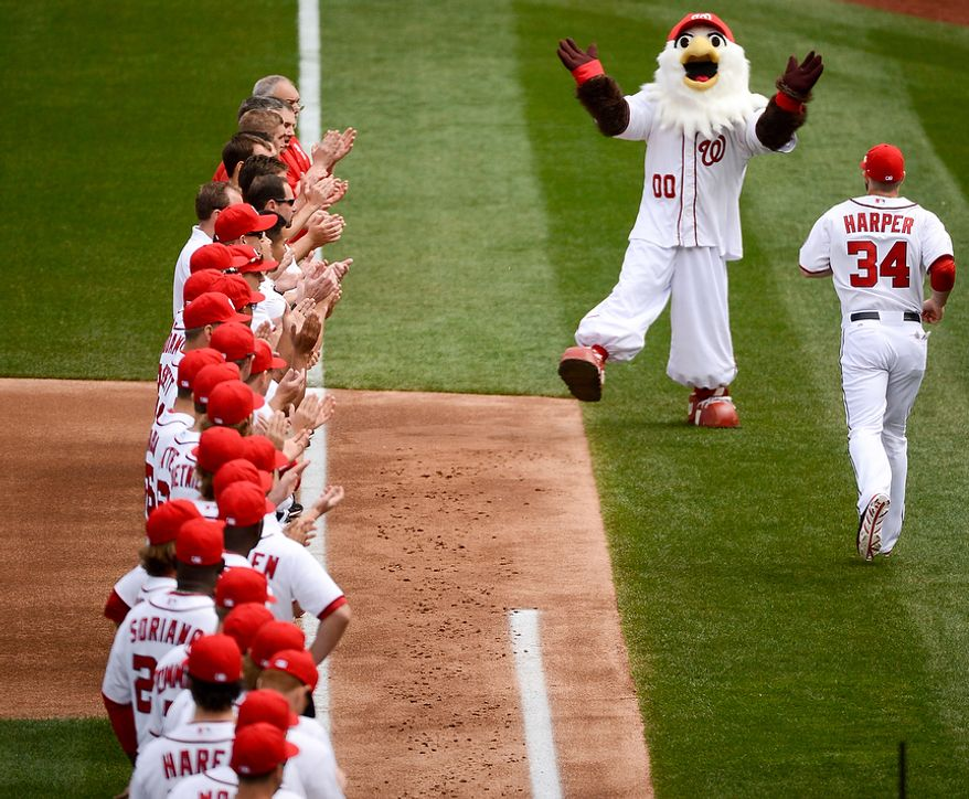 Washington Nationals center fielder Bryce Harper (34) takes the field with his teammates during introductions Washington Nationals play the Miami Marlins on opening day at Nationals Park, Washington, D.C., Monday, April 1, 2013. (Andrew Harnik/The Washington Times)