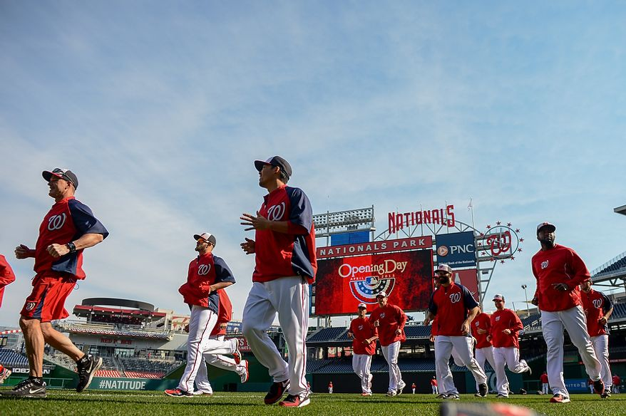 The Washington Nationals warm up before they play the Miami Marlins on opening day at Nationals Park, Washington, D.C., Monday, April 1, 2013. (Andrew Harnik/The Washington Times)