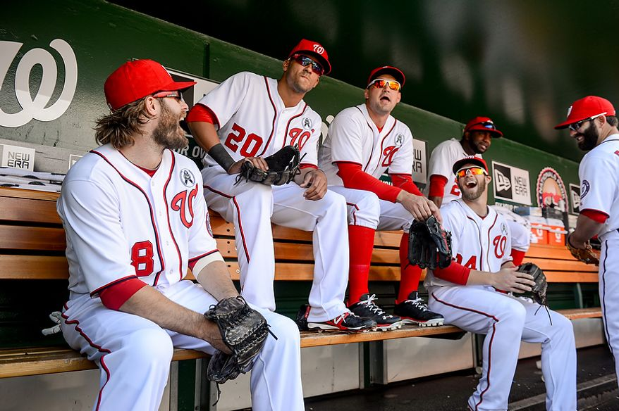Washington Nationals players laugh together as they wait to take the field to play the Miami Marlins on opening day at Nationals Park, Washington, D.C., Monday, April 1, 2013. (Andrew Harnik/The Washington Times)