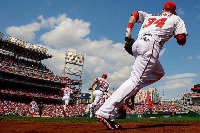 Washington Nationals left fielder Bryce Harper (34) takes the field with teammates to play the Miami Marlins on opening day at Nationals Park, Washington, D.C., Monday, April 1, 2013. (Andrew Harn