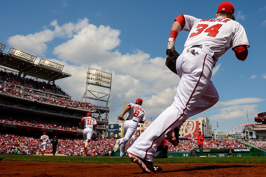 Washington Nationals left fielder Bryce Harper (34) takes the field with teammates to play the Miami Marlins on opening day at Nationals Park, Washington, D.C., Monday, April 1, 2013. (Andrew Harnik/The Washington Times)