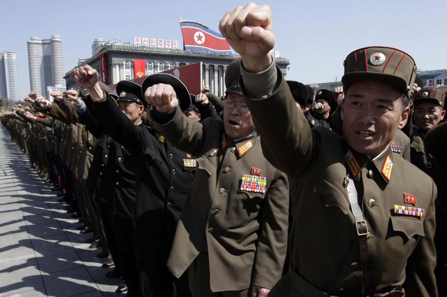 ** FILE ** North Korean army officers rally at Kim Il-sung Square in Pyongyang. (Associated Press)